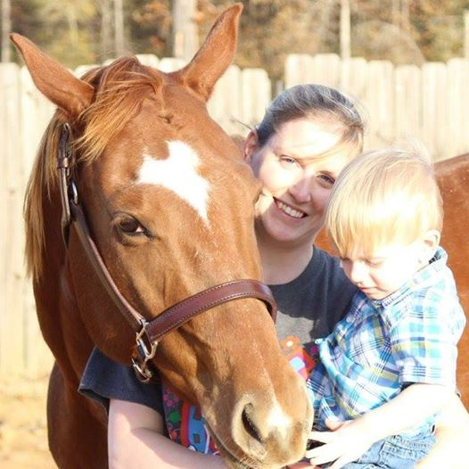 Team member Mary with her son and horse